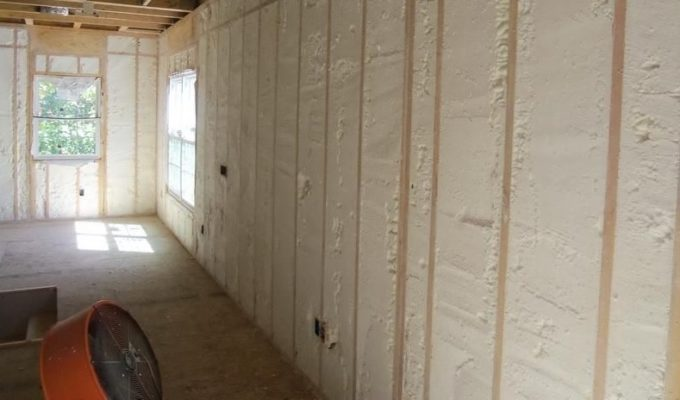 Drywall or playwood over the layer of insulation
